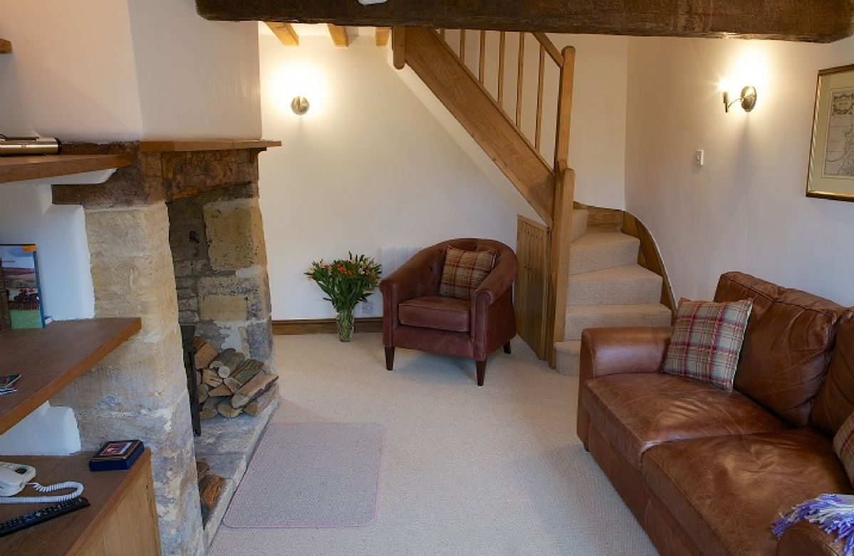 Ground floor:  Sitting room with wood burning stove, shuttered windows and window seats