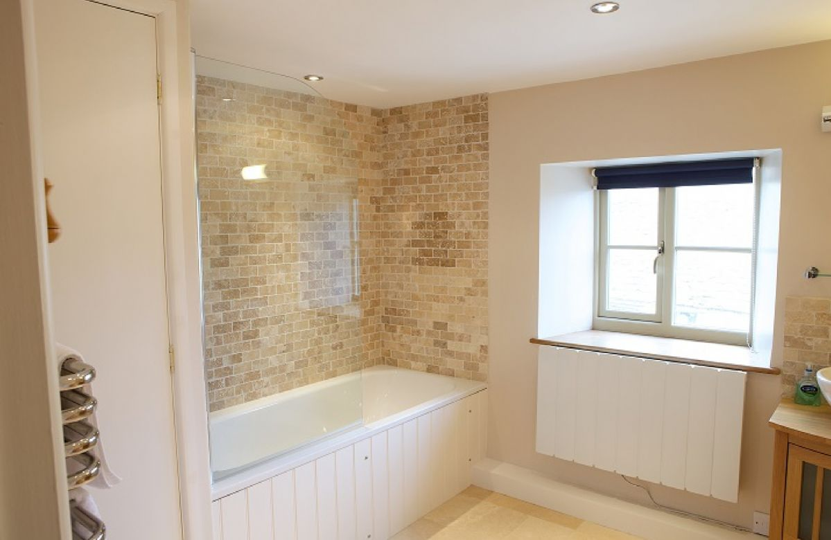 First floor: Bathroom with shower over bath