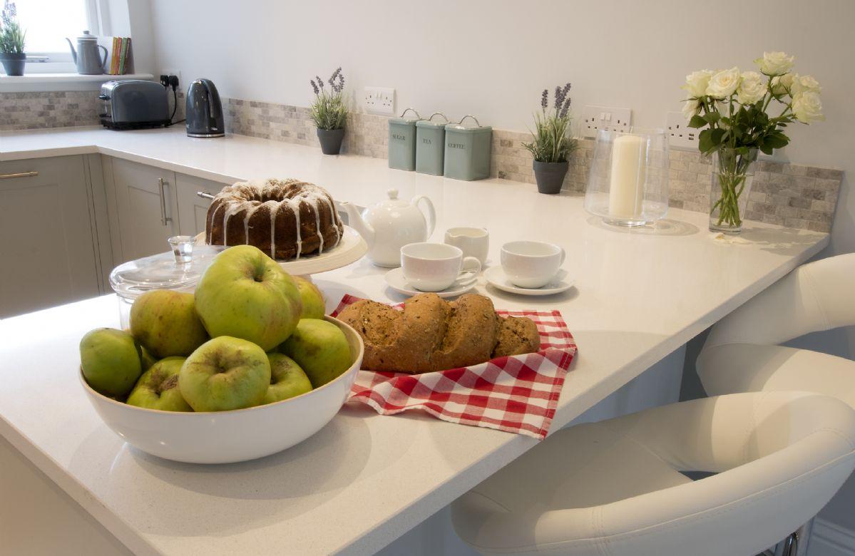 Ground floor:  Kitchen with breakfast bar