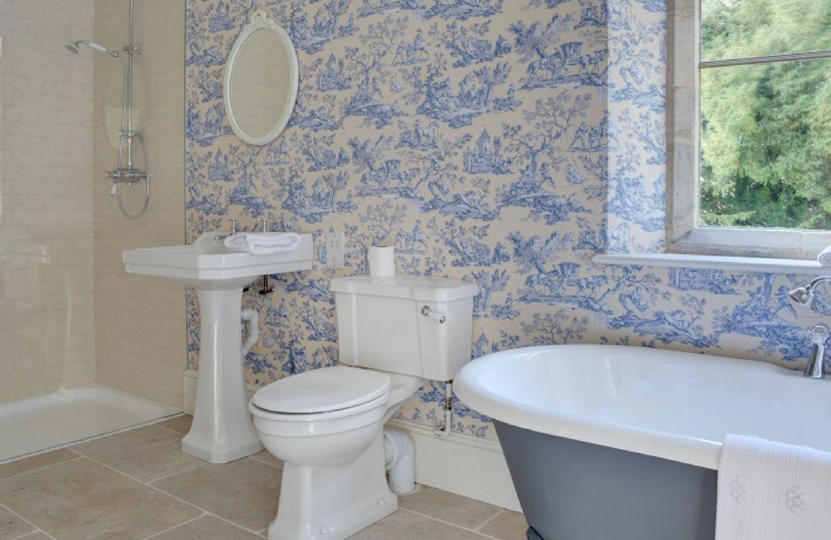 First floor: En-suite bathroom with roll top bath and walk in shower