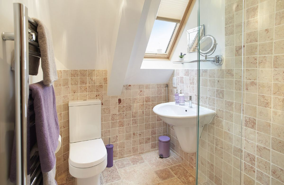First floor:  Pink Italian marble en-suite bathroom with walk in shower