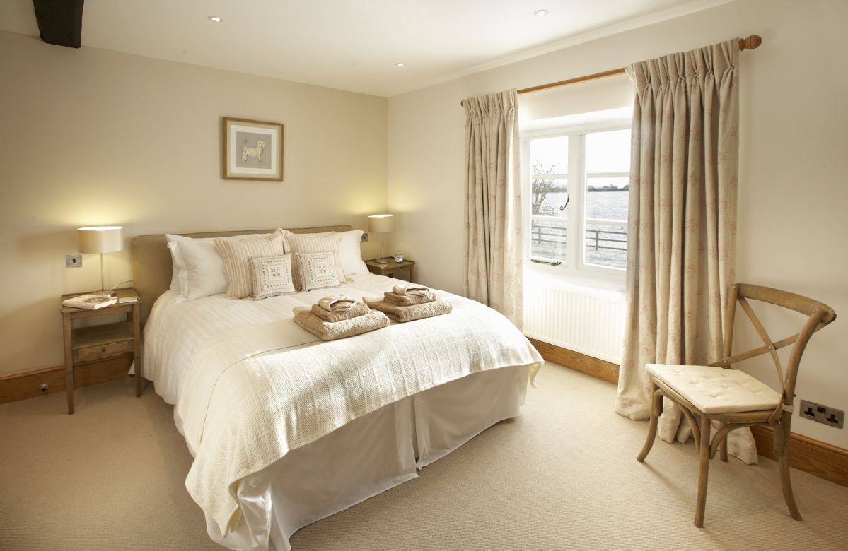 First floor: Double bedroom with a 5' bed and en-suite bathroom with shower over bath