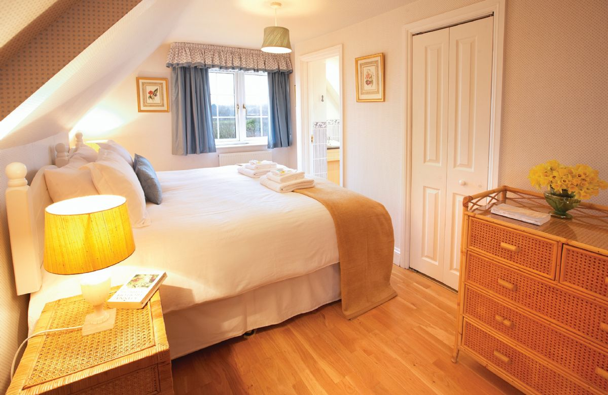 First floor: Double bedroom with 6' bed with en suite bathroom with shower attachment, basin and wc