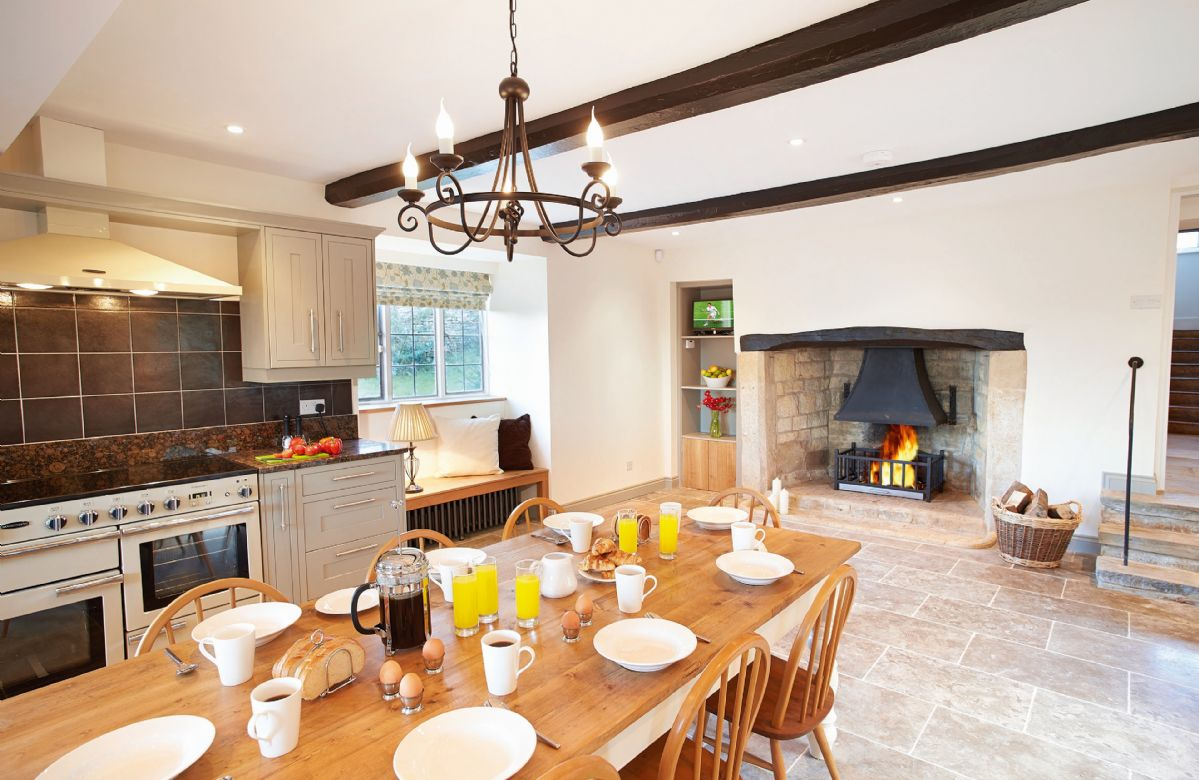 Ground floor: Large farmhouse kitchen with breakfast table and open fire