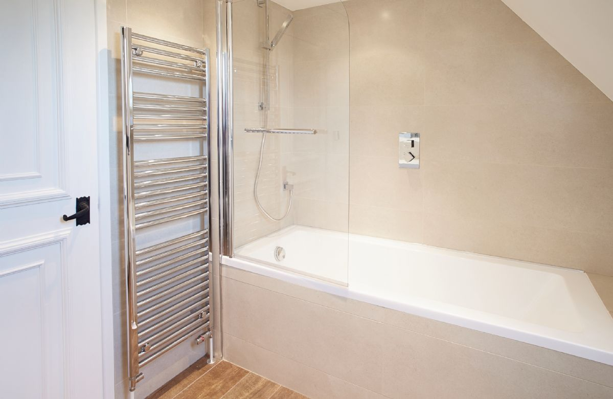 Second floor: En suite bathroom with bath and shower over to double bedroom with 6' bed