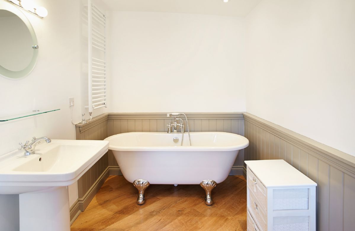 First floor:  En-suite bathroom to previous double bedroom with roll top bath