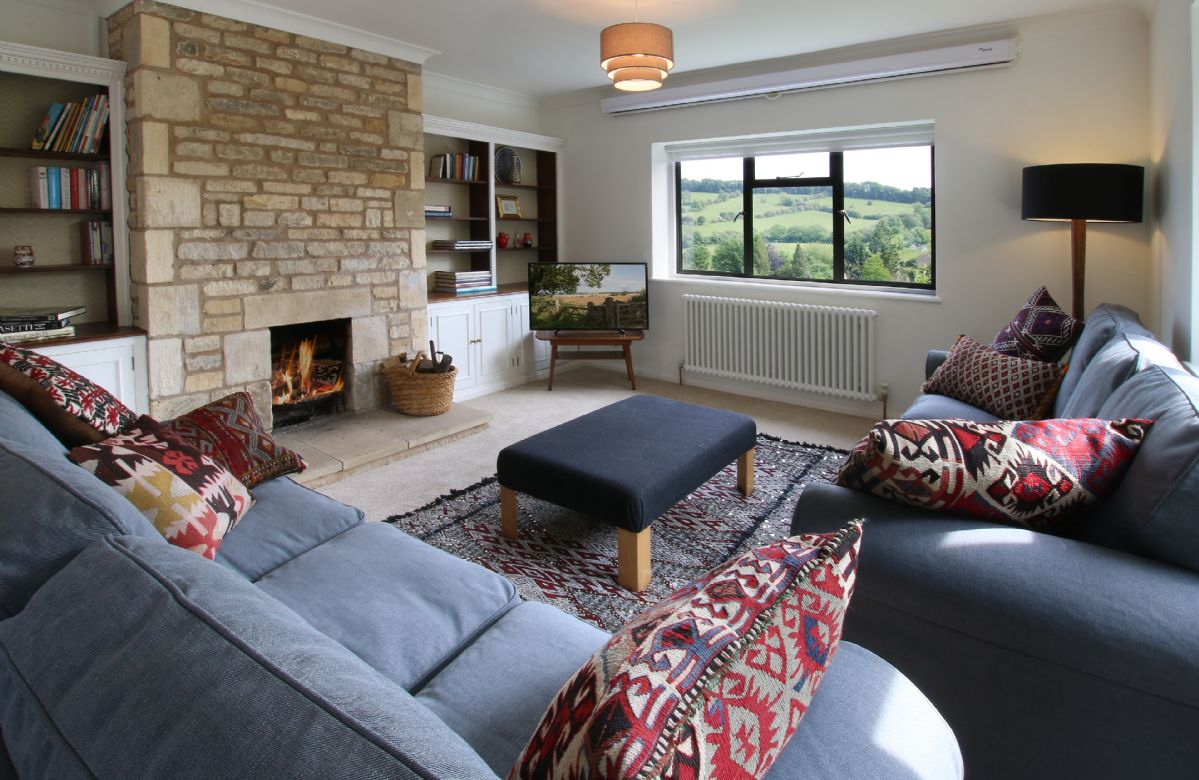 Ground floor:  Triple aspect sitting room with an open fire