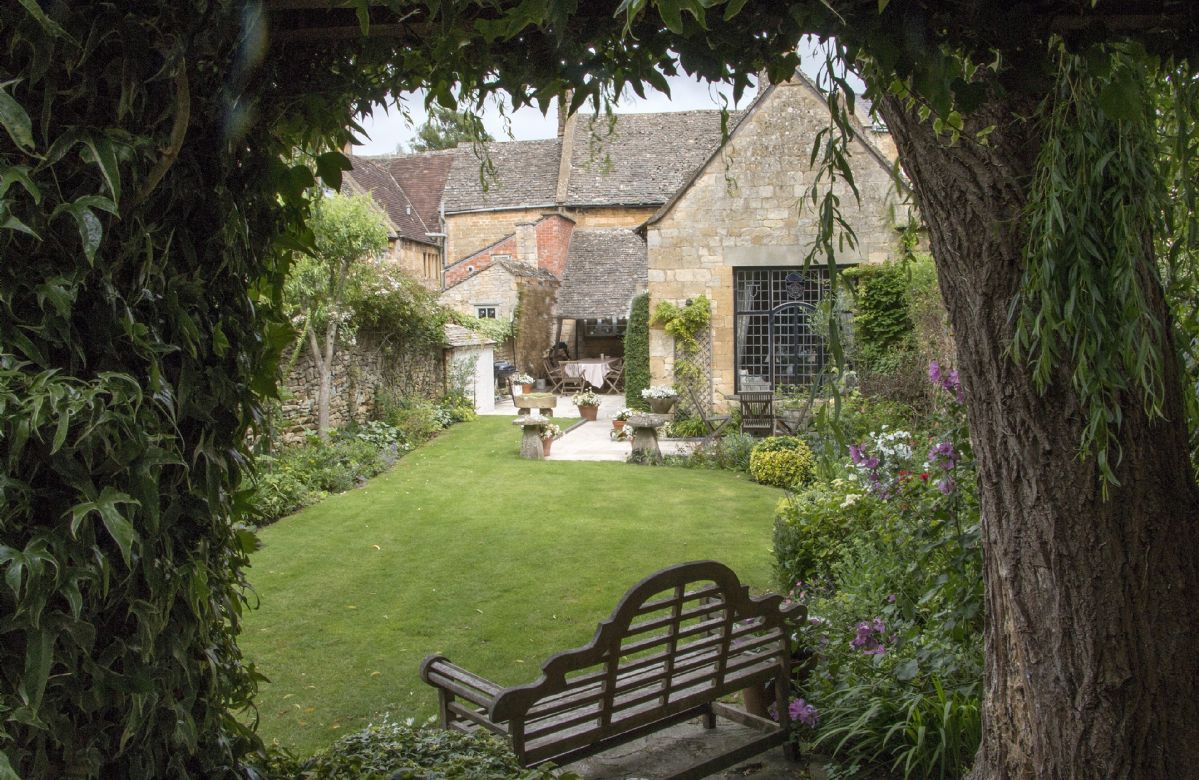 Charming walled garden with outdoor seating area