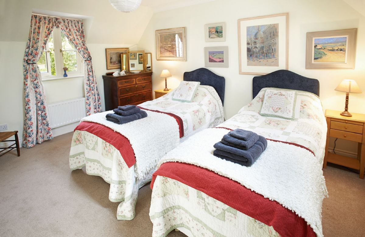 First floor: Twin bedroom with 3' beds with adjoining shower room