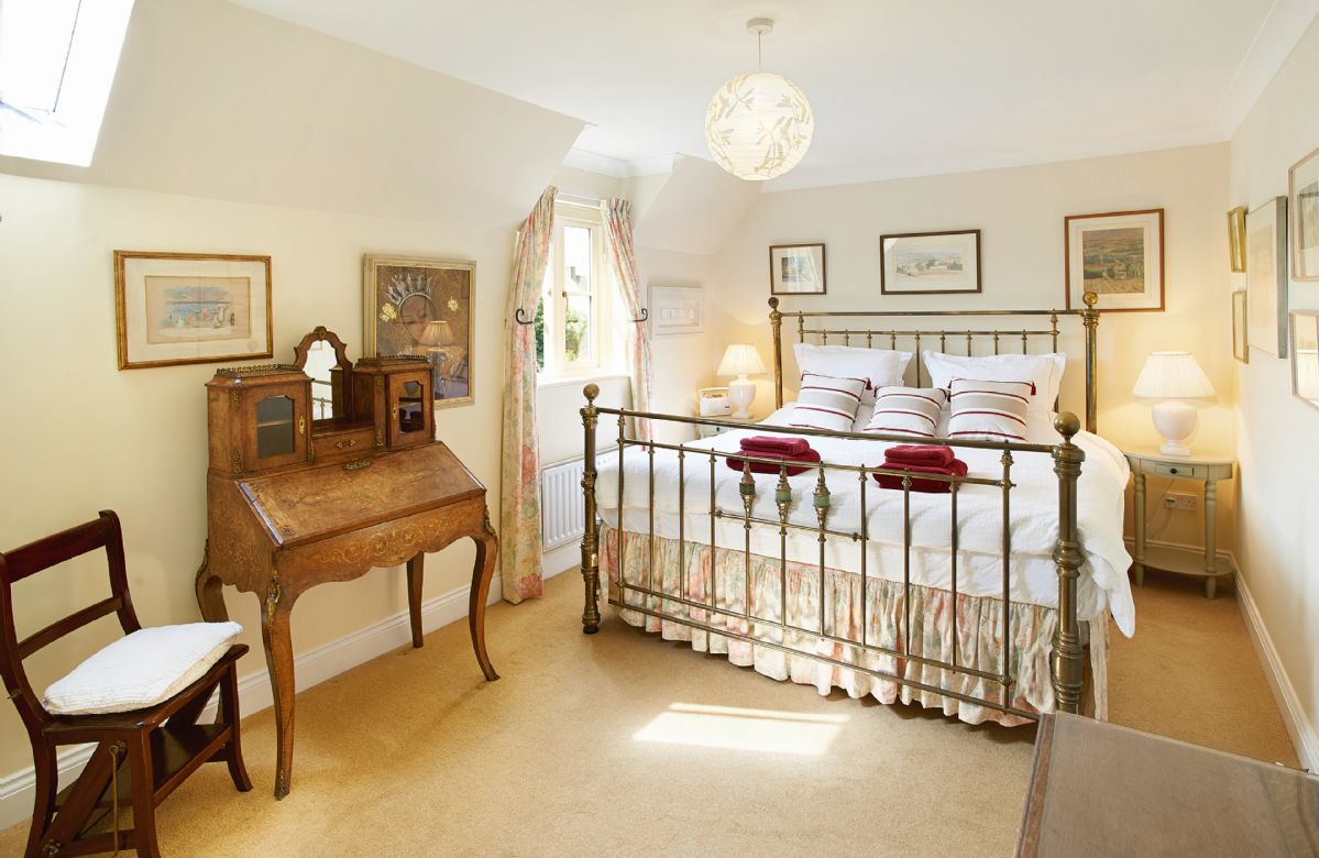 First floor: Master bedroom with 7' bed with en-suite bathroom with spray attachment