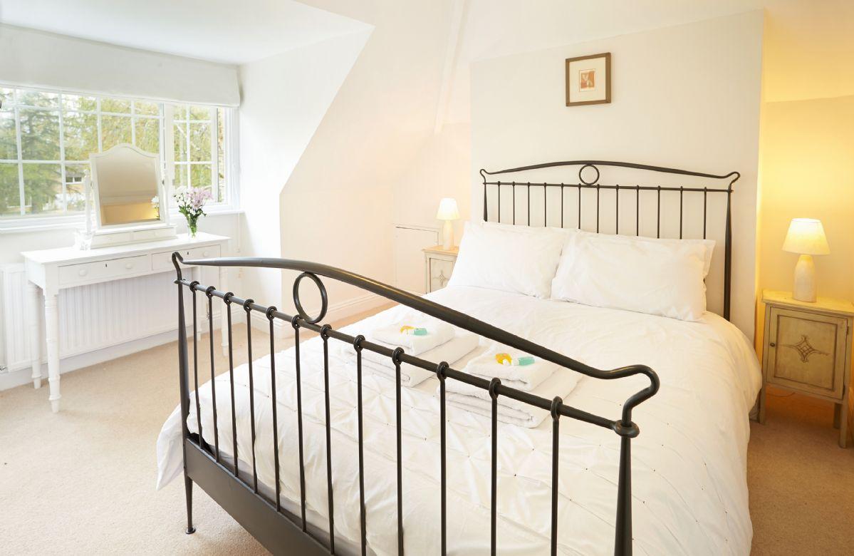 First floor: Double bedroom with 5ft bed and en-suite shower room
