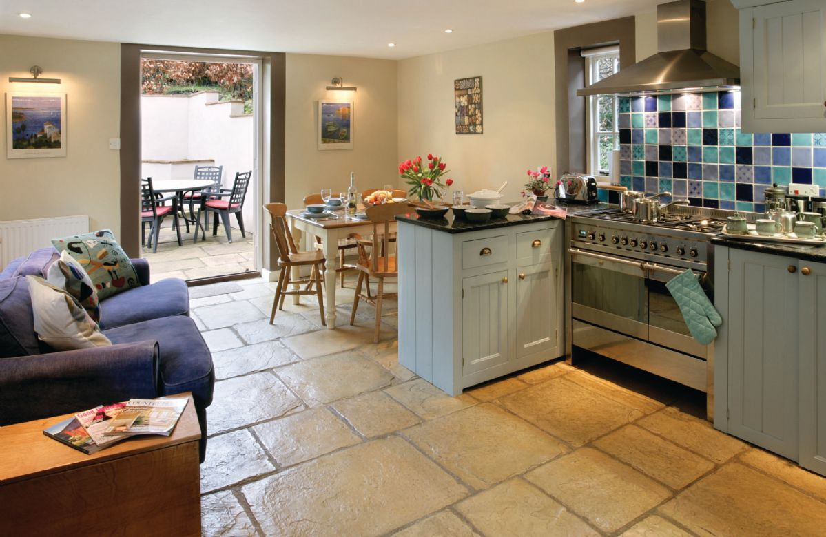 Ground floor: Kitchen with french doors onto the pation. Perfect for al fresco evenings.