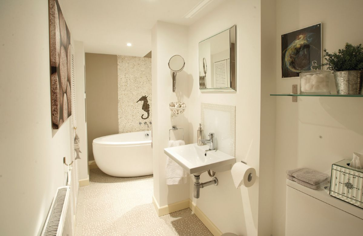 En-suite bathroom, large free standing bath, walk in, tiled power shower with heated towel rail