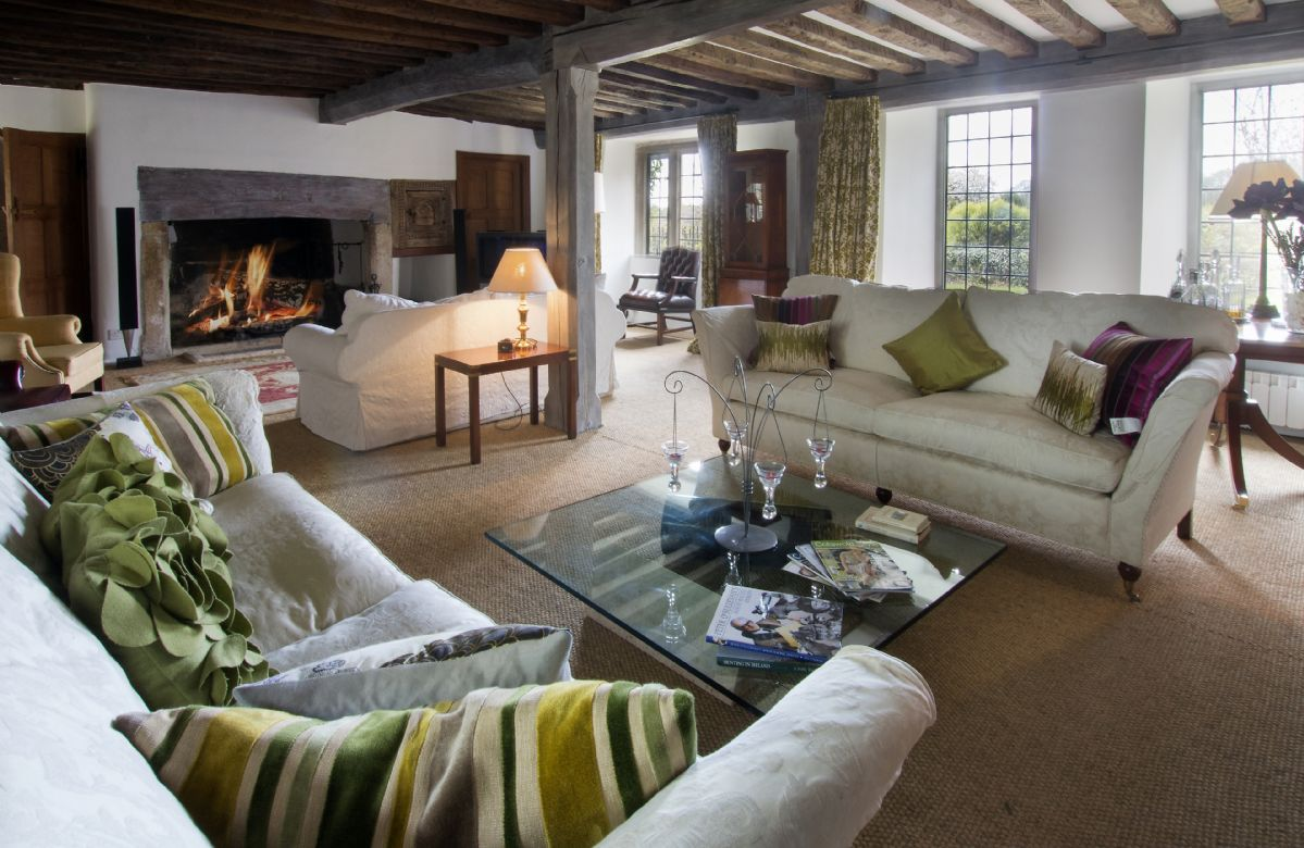 Ground floor:  Drawing room with inglenook fireplace and open fire