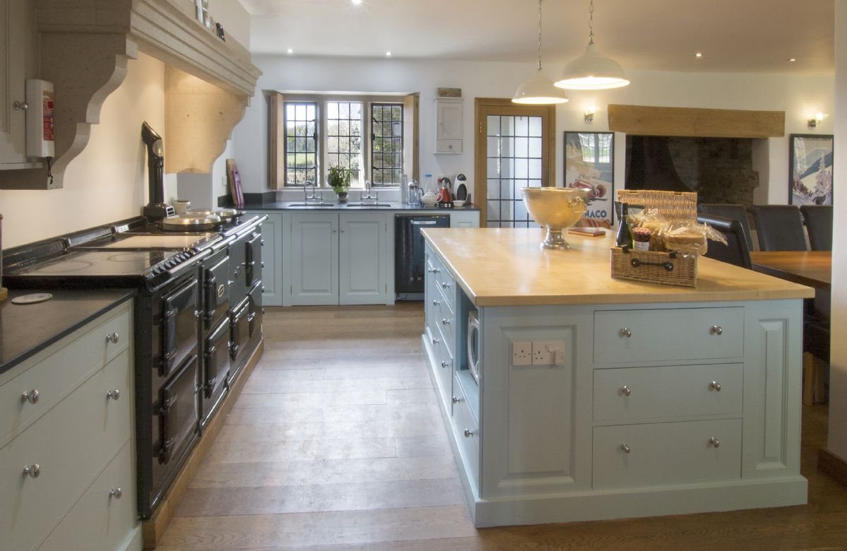 Ground floor:  Fully fitted kitchen/breakfast room with Aga and seating for 16 guests