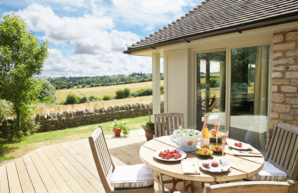 Decked area with garden dining furniture and glorious views