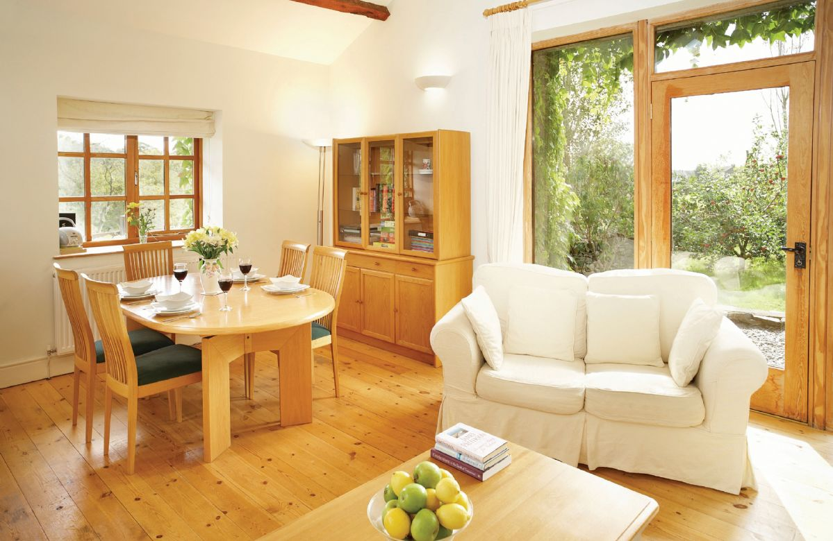 Ground floor: dining, kitchen and sitting area with multi-fuel burning stove