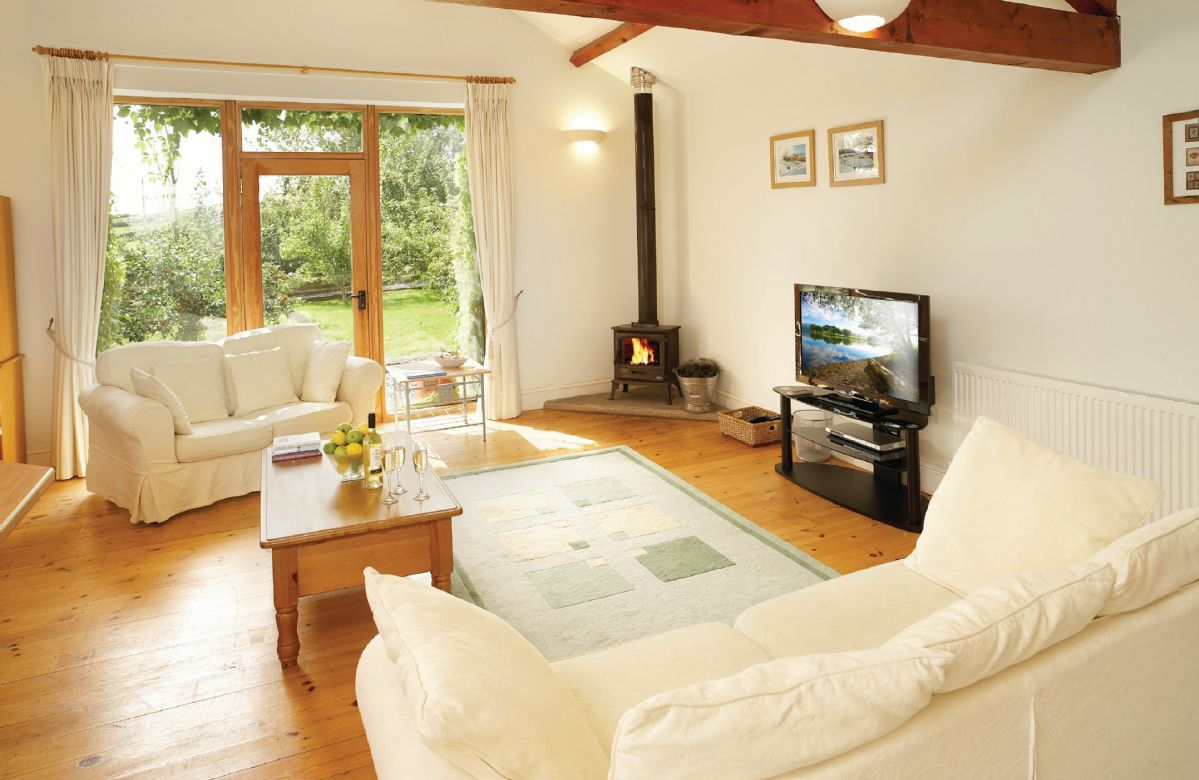 Ground floor: Open-plan sitting area with multi-fuel burning stove, dining area and kitchen