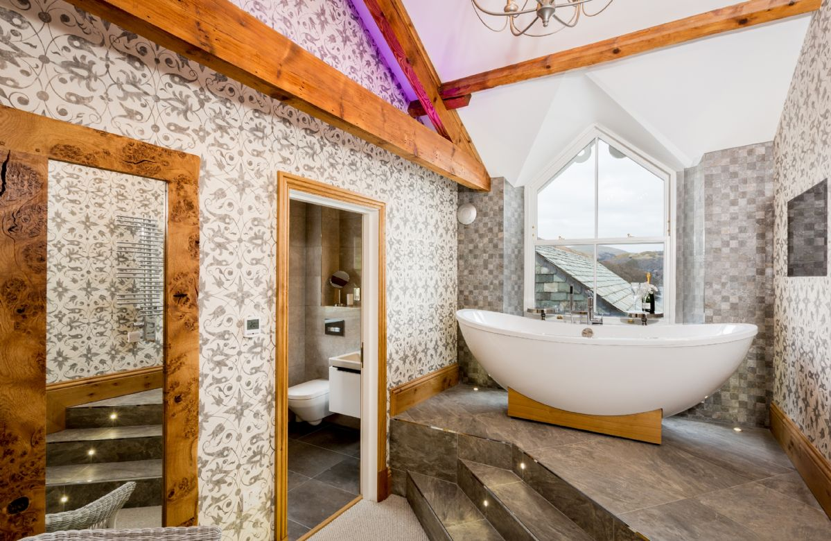First floor: Pikeawassa - en-suite natural stone bathroom with raised bath and separate monsoon and raindrop showers