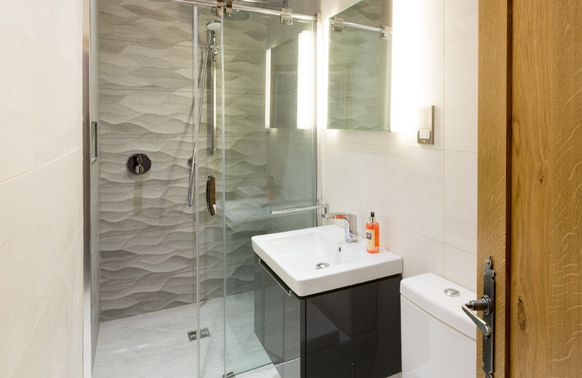 First floor: Fusedale - en-suite natural stone shower room with monsoon and raindrop showers