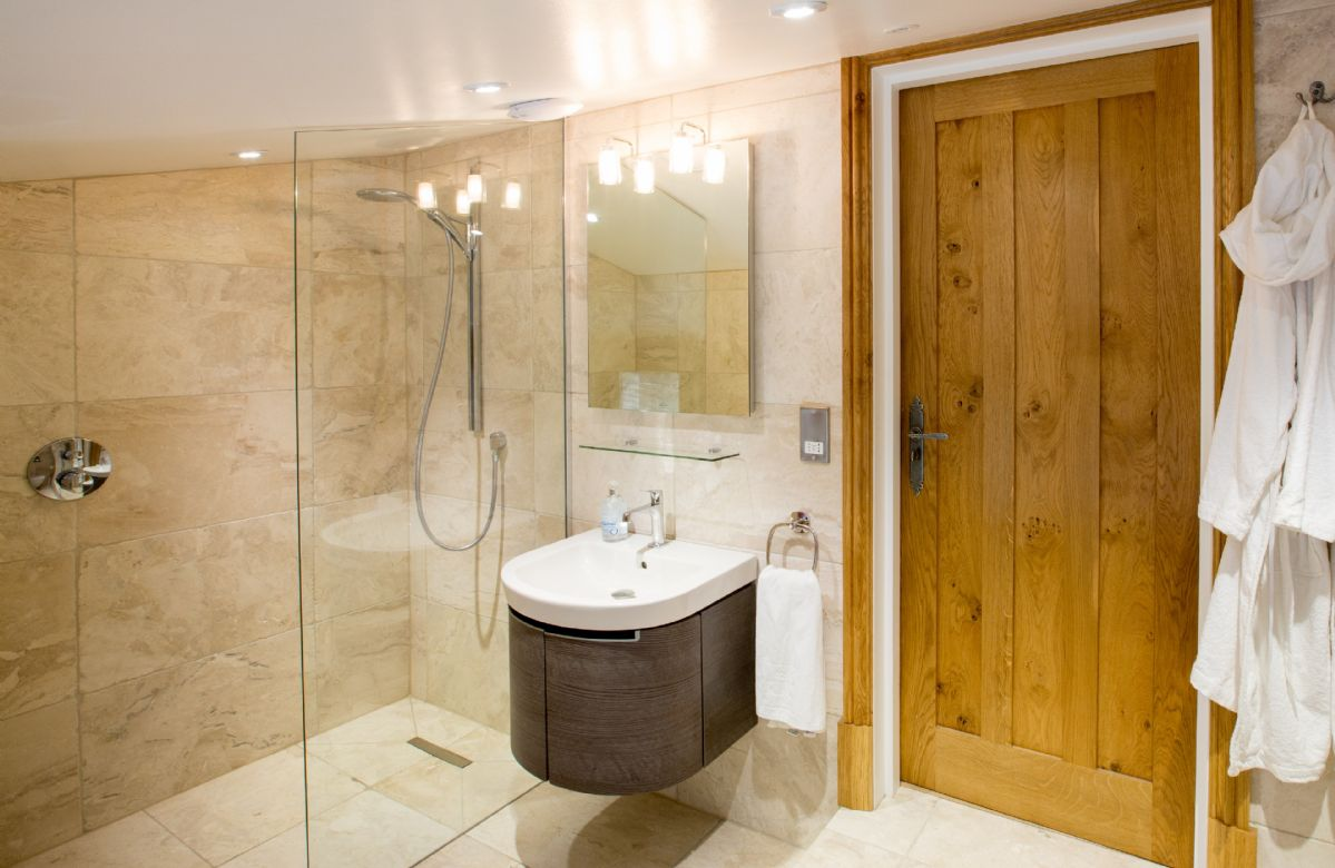 First floor: Boredale - en-suite natural black stone shower room with monsoon and raindrop showers, a Lake View balcony and private access to Waternook's Spa and Wellness Sanctuary