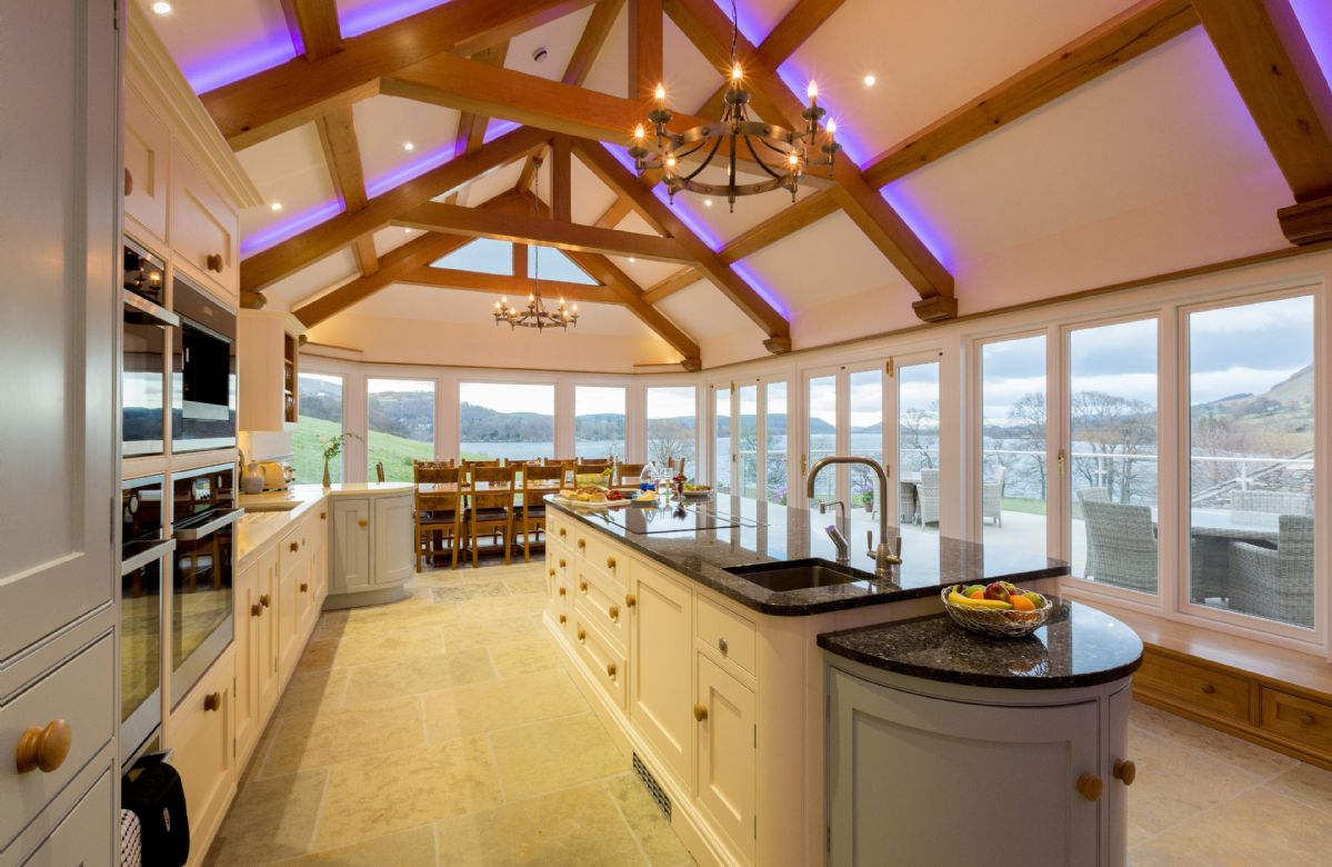 Ground floor: Kitchen with double aspect lake views and french doors opening onto terrace