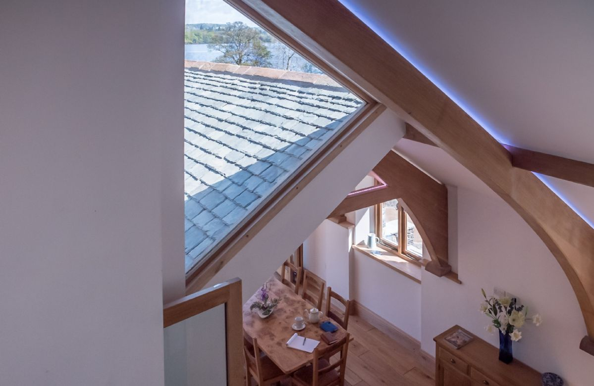 First floor: Staircase with views to the lake
