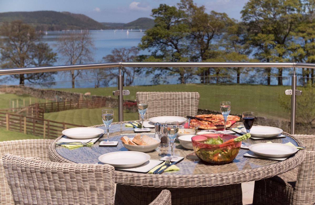 Waternook: Lake view terraced gardens with seating and barbecue terrace with barbecue equipment