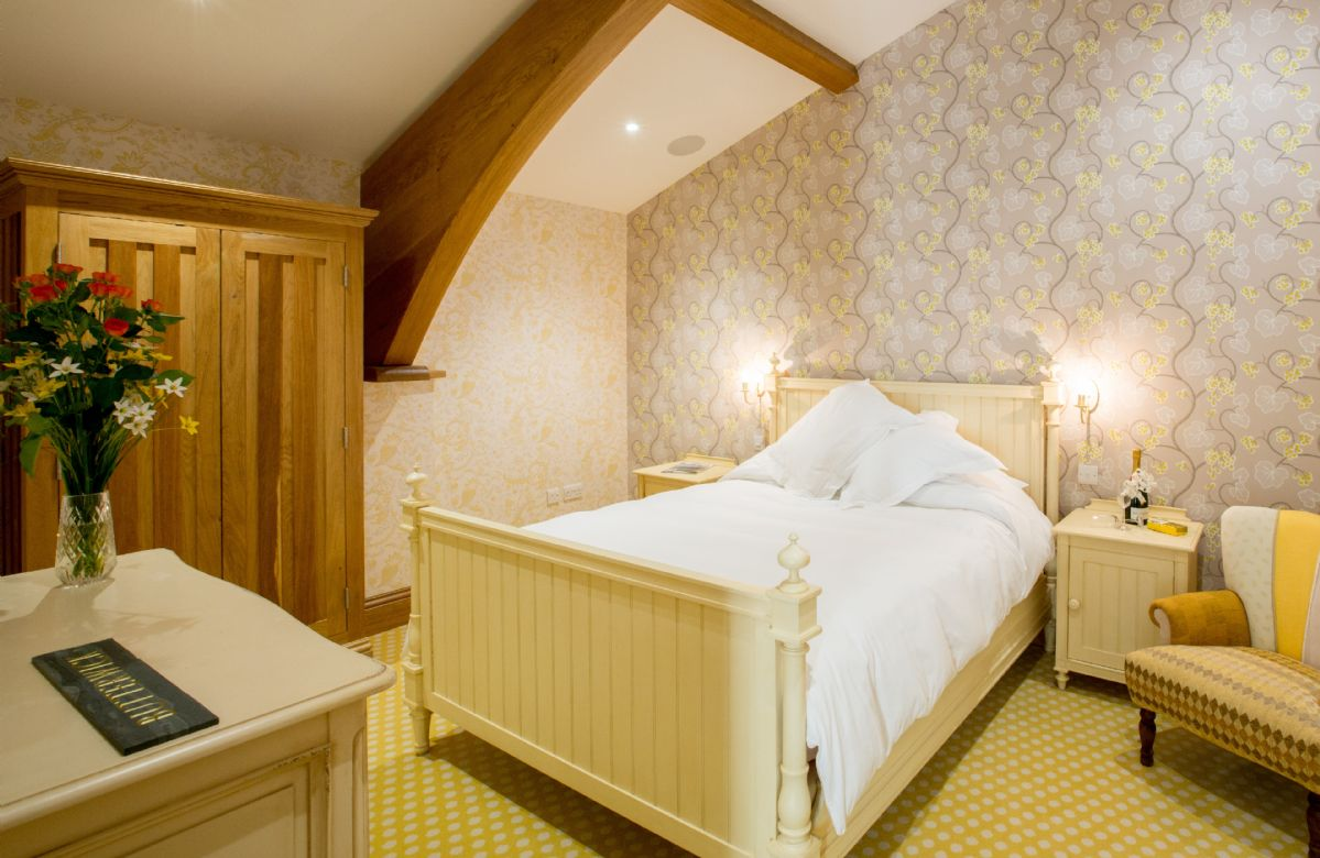 The Great Barn: Butterwick - Bedroom with 5' double bed and en-suite natural stone shower room with walk in monsoon and raindrop shower