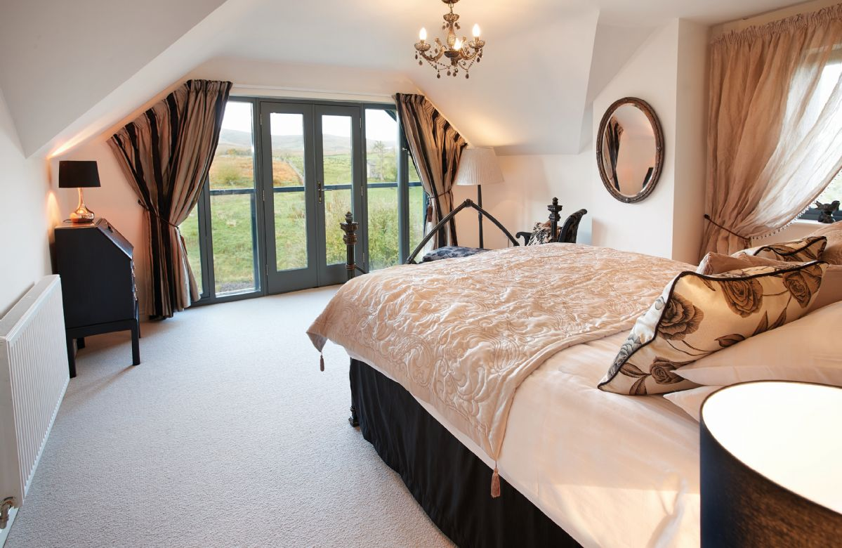 First floor: Master double bedroom with 5' bed and en-suite bathroom with bath and separate shower