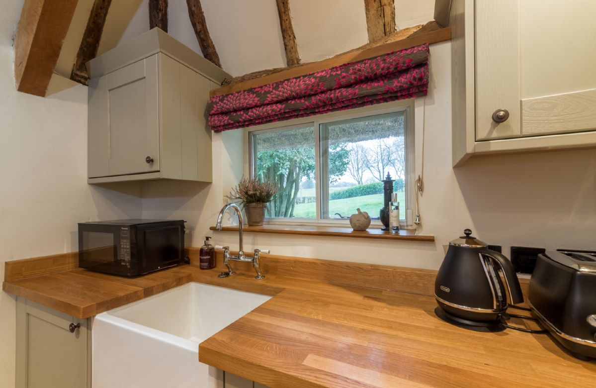Ground floor: The kitchen has views out on to the pretty cottage garden