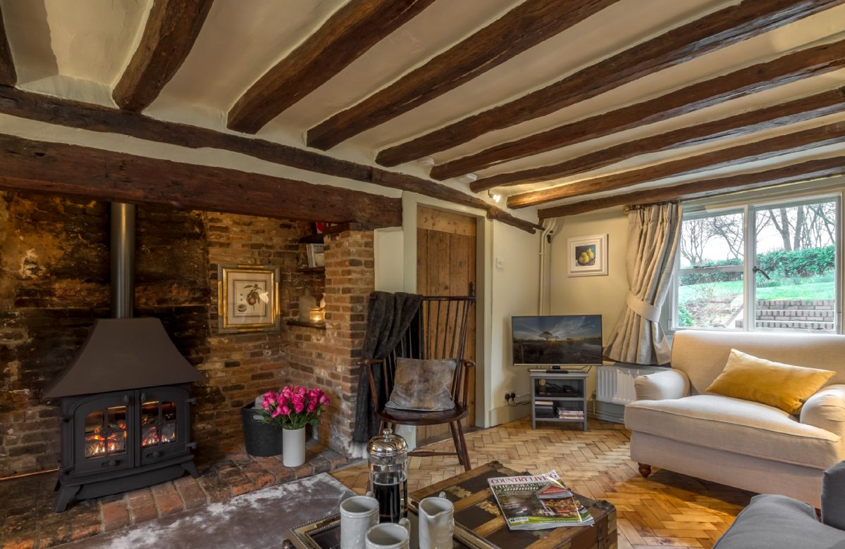 Ground floor: The sitting room features an inglenook fireplace with traditional gas stove