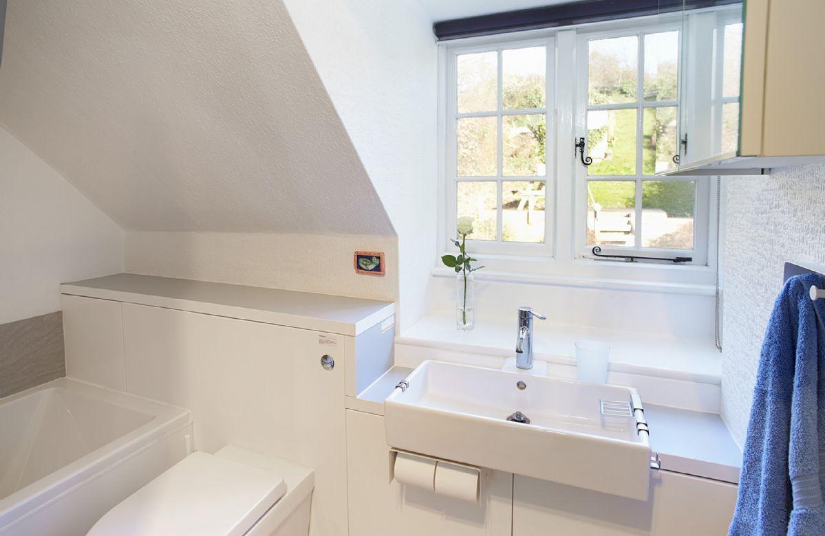 First floor:  Family bathroom with shower over bath