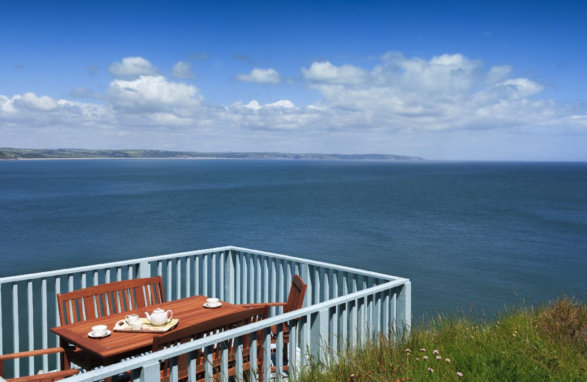 Decked patio area overlooking the cliffs and the sea