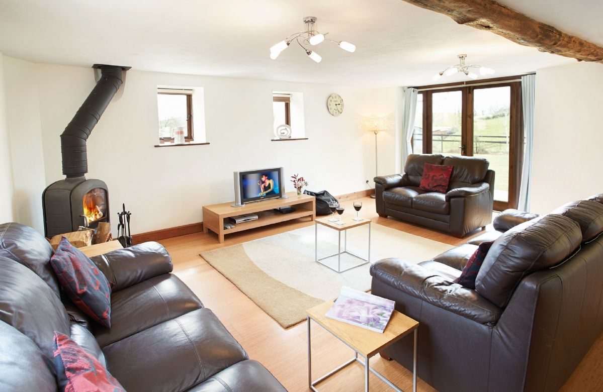 Ground floor: Large sitting room with wood burning stove and french doors to terrace