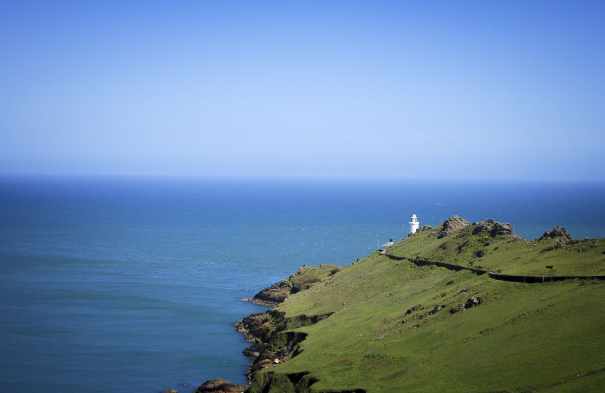The lighthouse lies on a dramatic headland above Start Bay