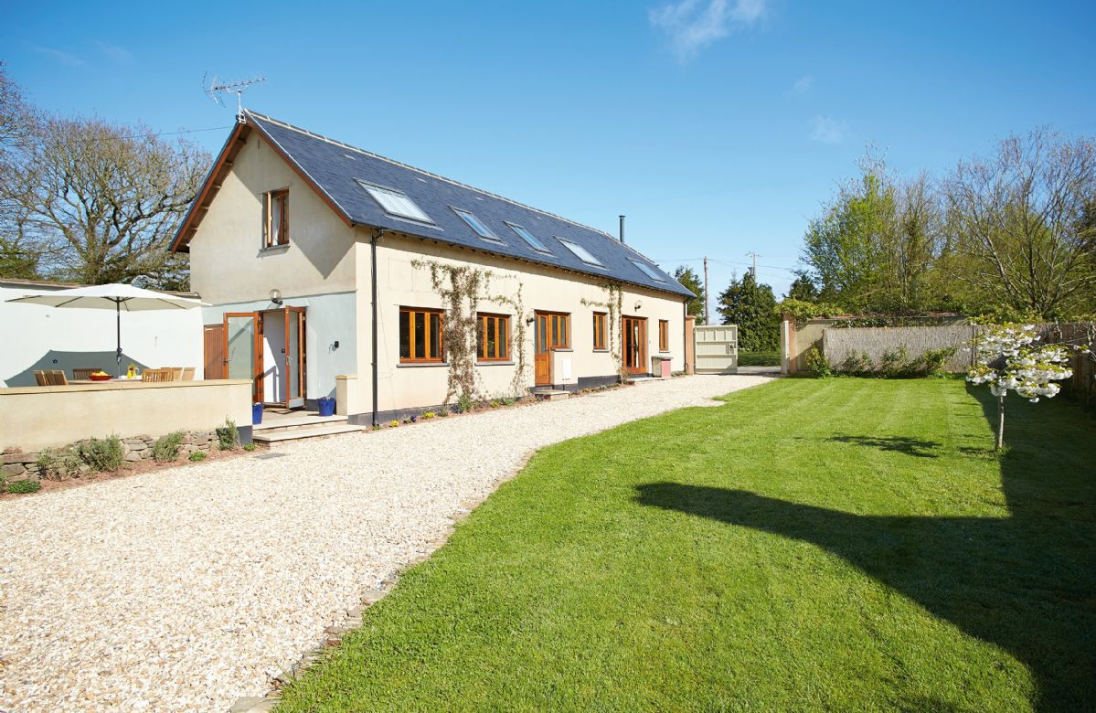 Long Meadow Barn is a charming, spacious detached converted barn set in the rural village of Down St. Mary. It is the ideal safe rural retreat set within its own garden