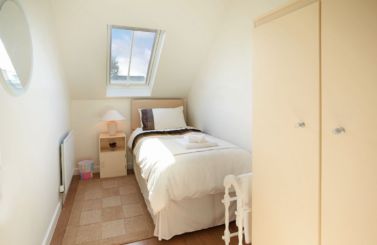 First floor: Single bedroom with 3' trundle bed which will accommodate either one adult or two children