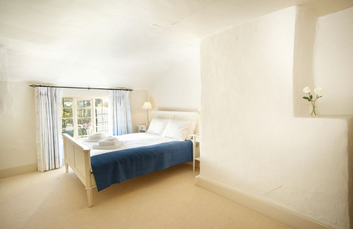 First floor: Double bedroom with 6' bed and en-suite bathroom with separate shower