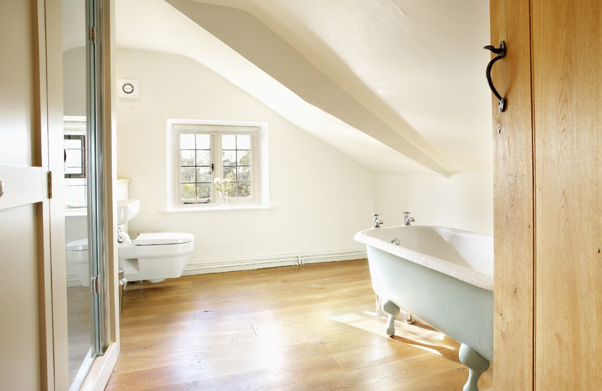 First floor: En-suite bathroom with separate shower to double bedroom with 6' bed