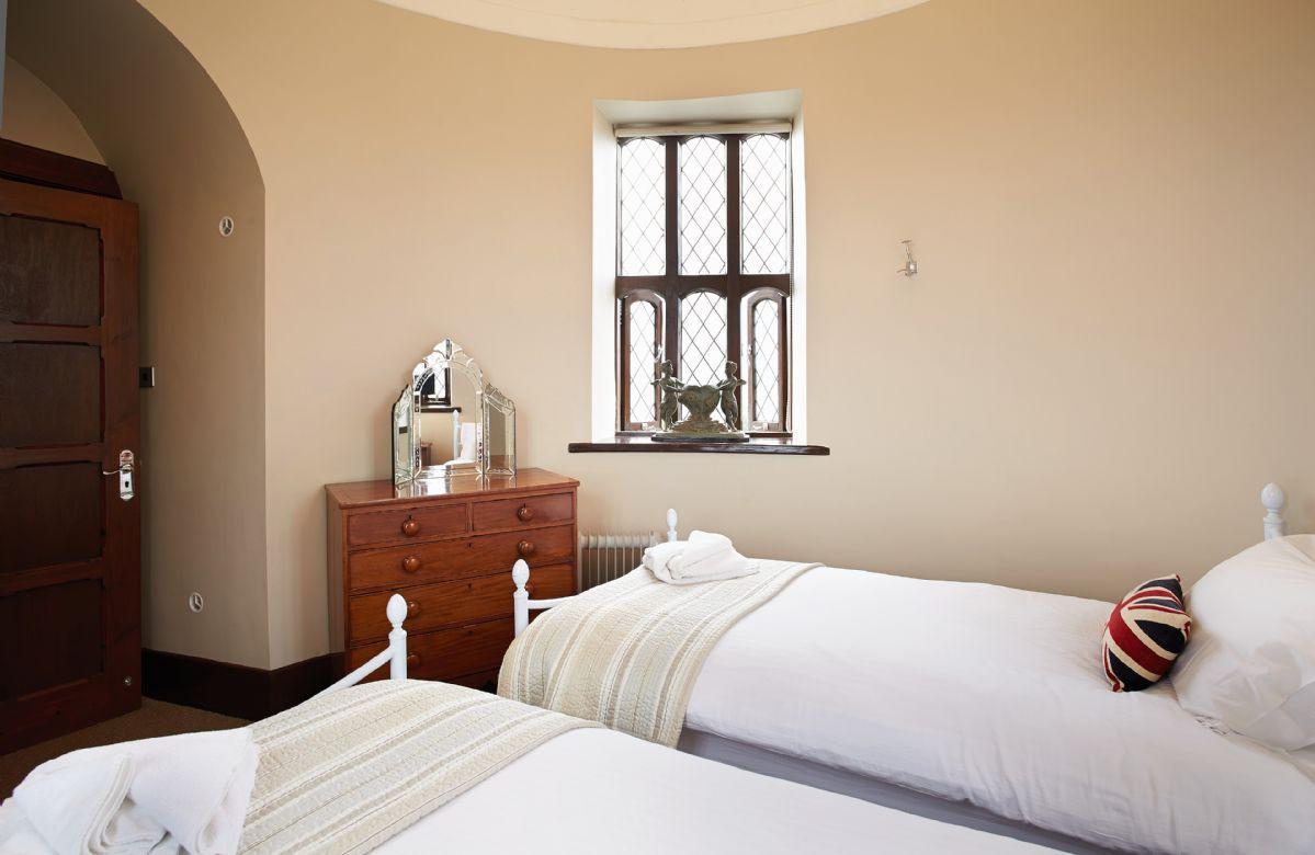 Tower second floor:  Circular twin bedroom with 3' beds