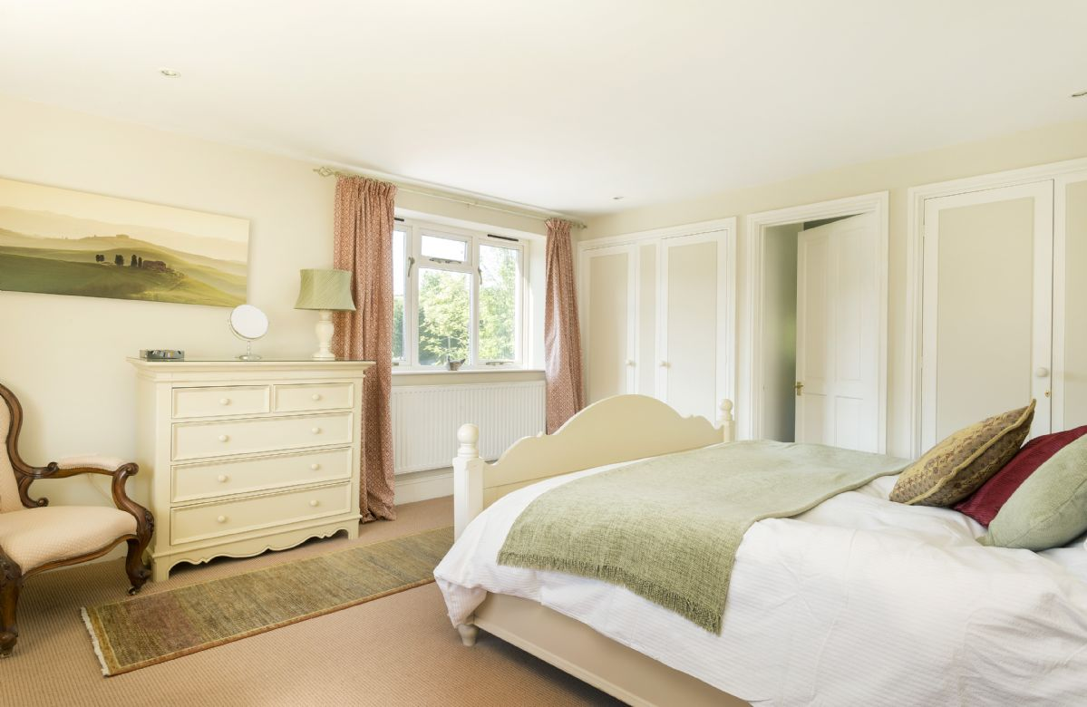 First floor:  Master bedroom with 6' bed and en-suite shower room with wc