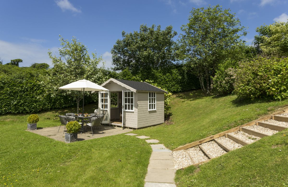 The stylish little Summer House is situated in the lovely garden grounds of Bittadon Cottage
