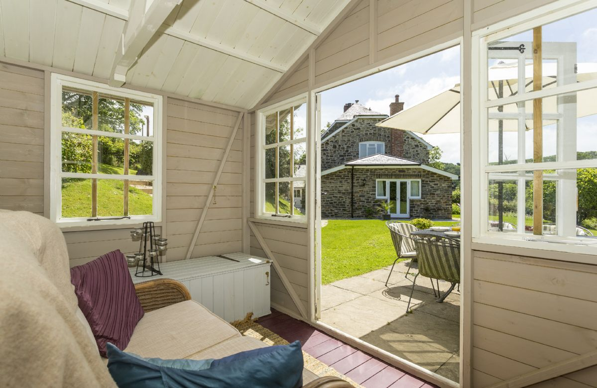Summer House: Cosy sitting area to relax in and enjoy the views out onto the garden