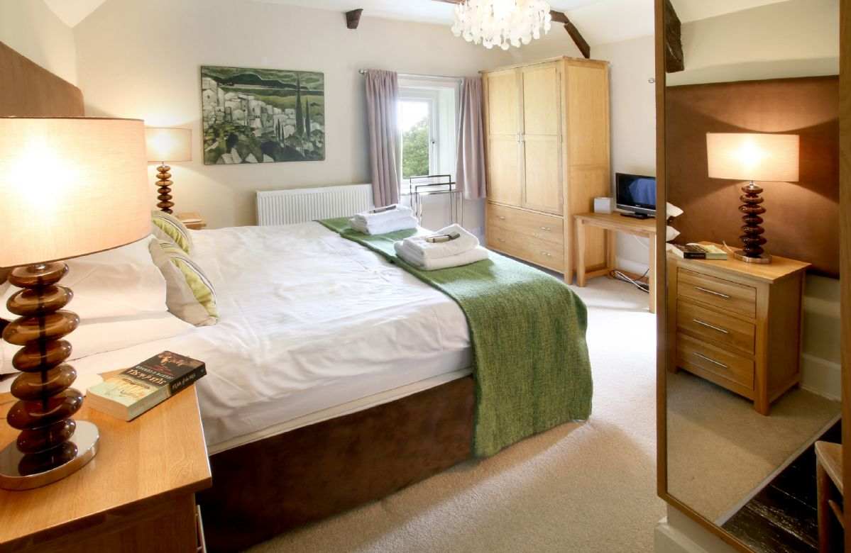 First floor: Double bedroom with 6' zip and link bed which can convert to 3' twin beds upon request with TV/DVD