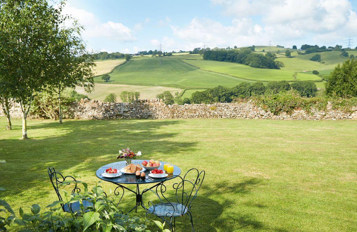 The terrace offers uninterrupted views down to the river and stretching several miles along and across the spectacular Yarty River valley with its pattern of small irregular fields and copses