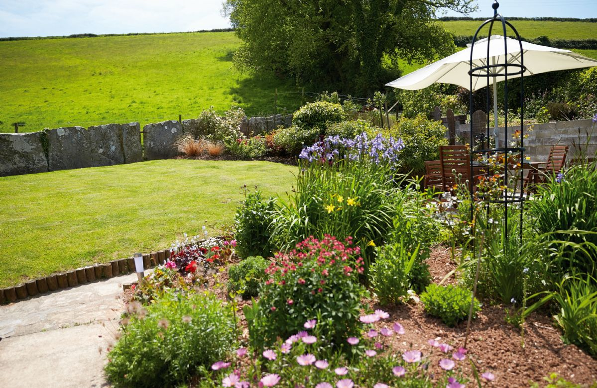 Delightful garden surrounded by 20 acres of pasture and farmland