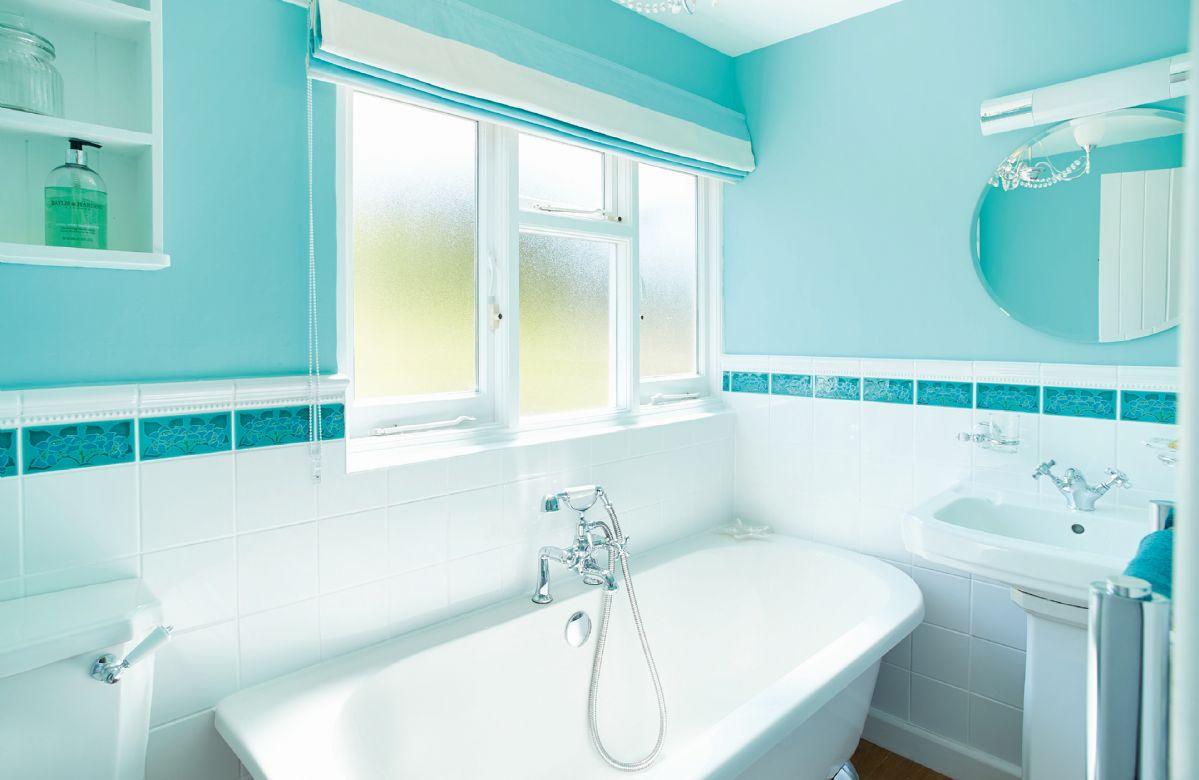 First floor: Family bathroom with roll-top bath
