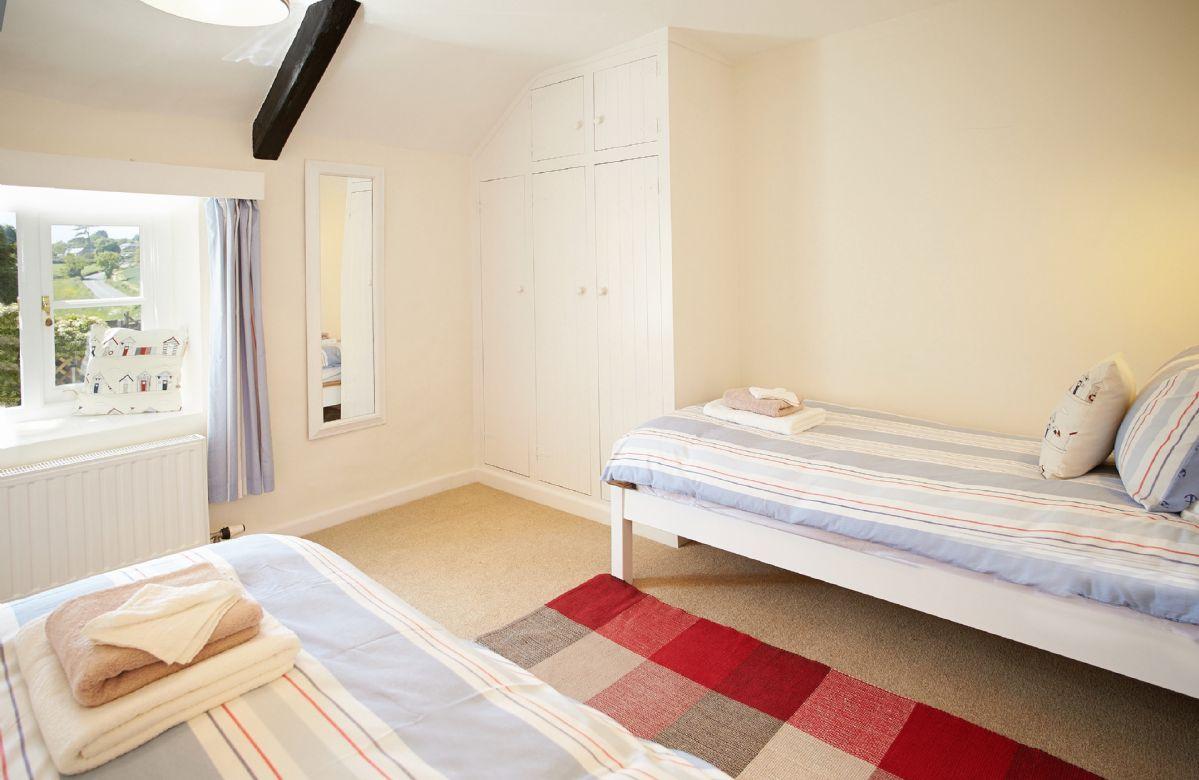 First floor: Twin bedroom with en-suite shower room