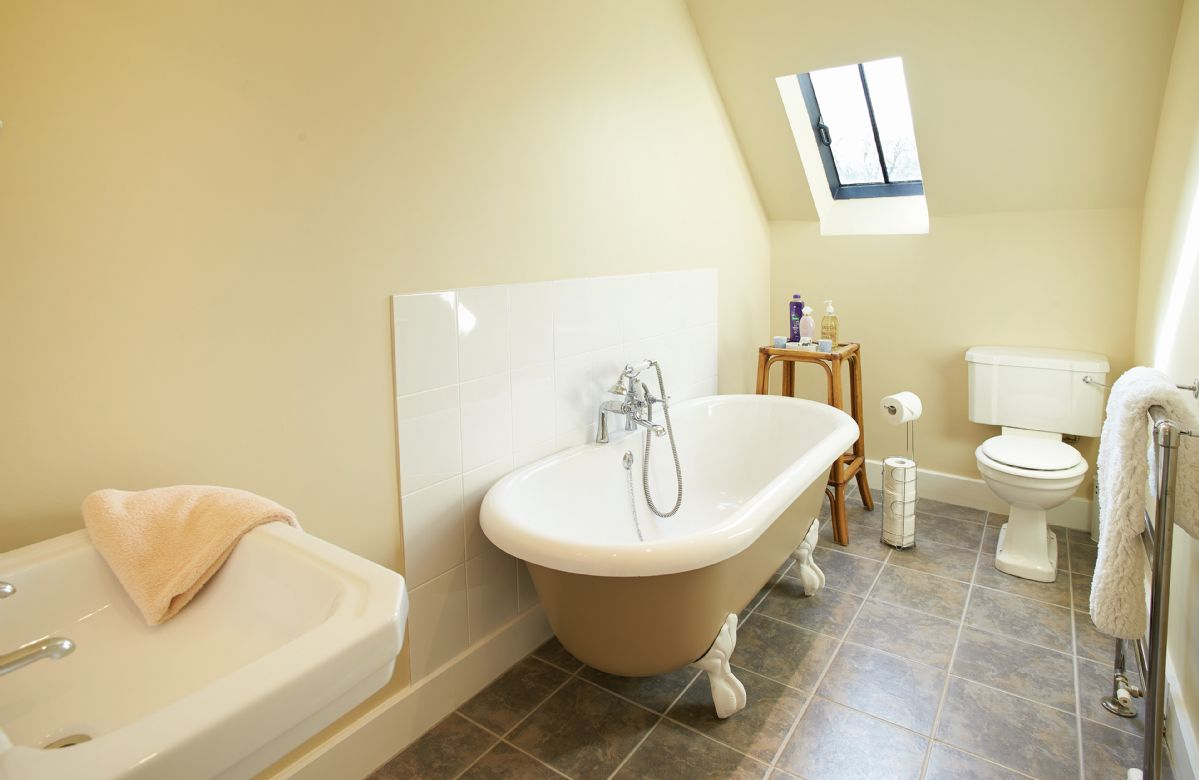 First floor: Bathroom with roll top bath